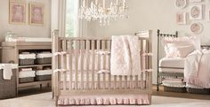 Rustic baby girl nursery design with wood crib and cabinetry decorated with pink carpet and bedding