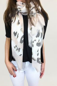 Easy styling for that street style look, our cotton scarfs are the perfect addition to your spring outfit.