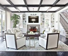 A Brentwood estate's transitional white #livingroom | See MORE at www.luxesource.com.| #luxemag #interiordesign #design #interiors #homedecor
