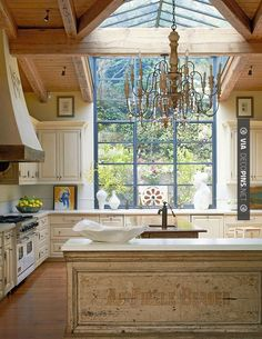 I LOVE this kitchen window merging into a skylight. Wow...!!!