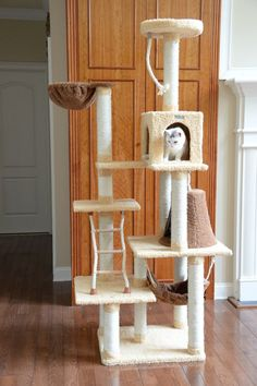 AMARKAT DESIGNER CAT TREE w/ KITTY HAMMOCK – FREE SHIPPING AND TAX INCLUDED on all designer cat trees.  No hidden fees on our website. Add style to your home with our luxury cat furniture.  Watch your kitties play and have fun our cat trees/cat condos. Shop now from and add style to your home with our luxury cat trees. These can also be used as scratching posts too! ON SALE TODAY!  #cat #cattree #designercattree #catcondo #kittycondo #scratchingpost #designerpetfurniture