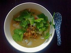 cup and table: cambodian rice porridge with crispy shallots and cilantro