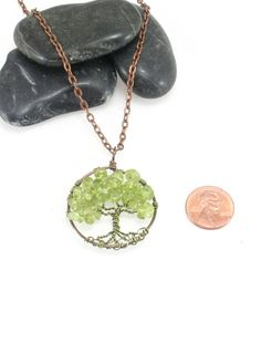 Tree Of Life Necklace Peridot Pendant Brown Chain and Wire Wrapped Tree Semi Precious Gemstone Jewelry August Birthstone Jewelry  Ready To Ship: You get the exact same pendant pictured.  The design for sale is a Tree of Life with Peridot on Brown artistic wire wrapped trunk and silver frame. It measures 1.5 diameter. All my handmade trees vary a little bit - they are individual trees with uniqueness of their own.  Peridot represents warmth, friendliness, understanding, openness in love and…