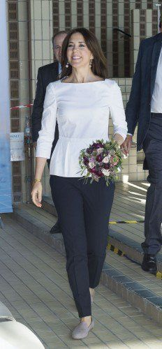 The Crown Princess looked stunning in a white peplum top which she combined with navy trousers.