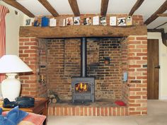 Clearview Vision 500 multi fuel stove installed into a thatched cottage with old Essex inglenook by Scarlett @ Design a fireplace 2008