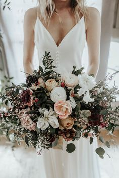 This is quite possibly one of the most diverse and visually captivating spring bridal bouquets we've ever seen | Image by Karra Leigh Photography