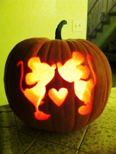 Mickey & Minnie Halloween pumpkin carving.