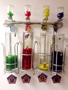 Harry Potter Great Hall Hogwarts House point jars as beta fish tanks! Hanging on my bathroom wall! Gryffindor wins the house cup!