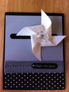 Dec. 11 -- Early start on New Year's cards. This is a spinner (very cool) that I made at Tami Waddell's Stampin' Up monthly card making class.