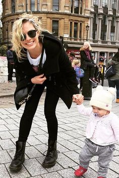 Margot Robbie wearing Dylan Kain the Rodriguez Gunmetal Bag and Dr. Martens 1460 Smooth Black Boots