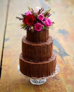 Cute mini tiered cake.  Inside, dark chocolate, red wine and cherry.