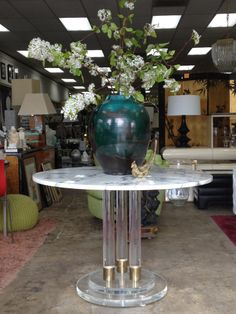 just arrived: Charles Hollis Lucite/Brass Foyer Table with Italian Carrera Top. Pretty Chic!