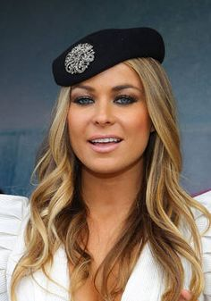 Carmen Electra shows us how to wear a brooch, by pinning it to the front of a beret.