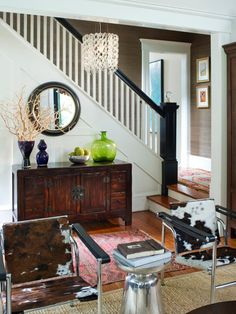 Circular mirror underneath the stair railing.  Love the placement of mirror.  Try in our house?