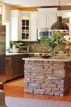 Stacked stone on island. Brick backsplash. Cabinets. by Olive Oyl