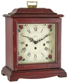 Hermle 22518-WH0340 Austin Distressed Red Carriage Mantel Clock   Made in Amherst, Virginia USA this american styled bracket clock is made from Cherry hardwood with a distressed Red finish. The 8-day mechanical movement features Westminster Chimes. Brass 8-day key wound movement plays 4/4 westminster chimes. night shut-off.  Available from http://www.theisenclock.com/mantel_clocks.html