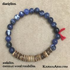 AFFIRMATION: I am, indeed, a leader, because I can rule myself. - 8mm Sodalite Round Natural Gemstones - Red Cotton Tassel - Coconut Wood Rondelles - Commercial Strength, Latex-Free Elastic Band - Han