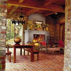 Love this room ~ looks like it could be outside ~ the brick on the floor and walls is beautiful and would certainly be low maintenance.