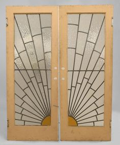 French Art Deco doors with sunburst leaded glass design. (did I mention that I love Art Deco?