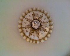 http://www.ebay.fr/itm/bouton-nacre-et-pierre-du-Rhin-XVIIIe-38mm-/131422708323?pt=FR_YO_Collections_Boutons