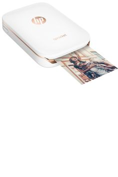 HP Sprocket Photo Printer (print phones directly from your phone or table), $129, hp.com - Tech Gift Guide: This Season's Chicest Gadgets - HarpersBAZAAR.com
