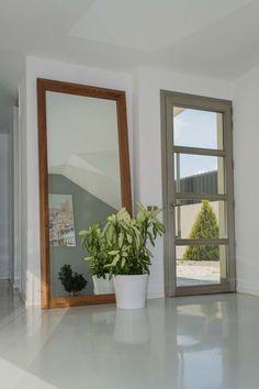 Vestíbulo de acceso en vivienda unifamiliar en Rivas, por ACGP Arquitectura