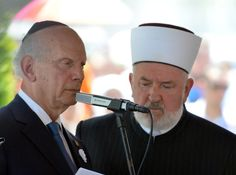 New York Rabbi Arthur Schneier (L), a Holocaust survivor who promotes inter-religious dialogue, delivers a speech during a mass burial ceremony at the Srebrenica-Potocari Memorial Cemetery in Potocari on July 11, 2012, next to Bosnian top Islamic cleric Mustafa Ceric, with whom he has been working closely for more than 20 years within the Appeal of Conscience Foundation (ACF)