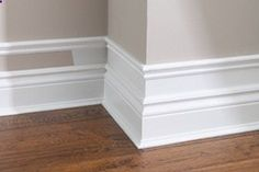 Make your baseboard more dramatic…add small pieces of trim to the top of existing baseboard, add a few inches and add another piece of moulding. Paint the wall and trim white. Cheap Easy!!!