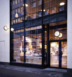 "BIT UNION AKERSGATA (OSLO): Warmly-lit exterior ""globes"" beckon passersby with a hint and promise of the unique and manicured cafe…"