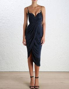 Sueded Silk Underwire Dress, from our Spring 16 collection, in French Navy sueded silk. Draped bodice and asymmetric skirt. Fully molded, boned underwire bodice with shoestring strap detail, V neckline and shoestring straps. Centre back zip closure. Fully lined.