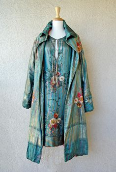 1920's chemise style dress fashioned of turquoise, purple and silver lame in a Japanese inspired floral motif hand embroidered with multi-co...