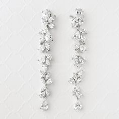 Elegant and gorgeous long earrings with marquise and teardrop CZ jewels. Post back, approximately 3.25 inches long.