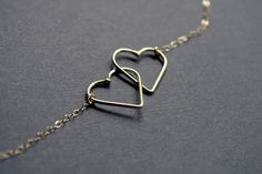 Hearts Entwined Necklace, crafted by Australian jewelry designer Epheriell & priced at AU$58, or US$40 + US$5 S&H Click for more of Epheriell's shiny & oxidized silver jewelry.
