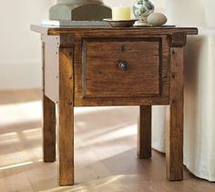 """Pottery Barn. Sawyer Side Table w/dowel pins, escutcheons, exposed battens.  Distressed Sungkai wood in Whiskey stain.  24""""Wx26""""Dx25""""H."""