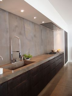 | P | Kitchen with concret counters + backsplash