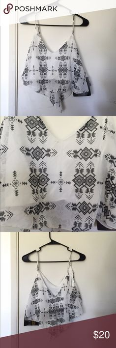 New Aztec printed crop top NWT black and white Aztec printed crop top, size medium. Material: 100% polyester. Straps are adjustable. Length (without straps): 12 inches Tops Crop Tops