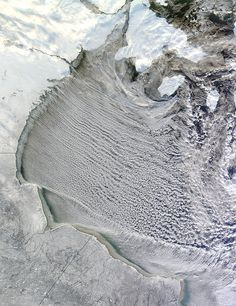 """NASA Satellite """"Drove Over"""" the Cloud Streets of Hudson Bay 