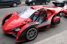 T-Rex, a $60k three wheeled BMW motorcycle powered vehicle, the earlier versions had various other motorcycle engines.