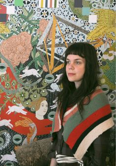 Cristina Toro with her painting