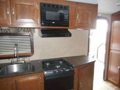 2016 New Keystone Passport Elite 23RB Travel Trailer in Wisconsin WI.Recreational Vehicle, rv, 2016 Passport Elite 23RB Front queen bed rear bath and sofa slide 4 stab. jacks, heated & enclosed underbelly, front diamond plate, 6 gal gas/elec wtr htr w/DSI, ext speakers, ext. shower, A/C, AM/FM/CD/DVD, painted cap, alum wheels, elec awning, elec tongue jack, and RVQ Grill