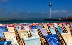 Colourful deckchairs on Weymouth. A community art project for 2012