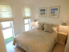 The master bedroom in Surf Lodges come with full height windows and king size beds