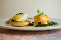 Artisanal Eggs Benedict (house-made English muffins and Canadian bacon, hollandaise.)