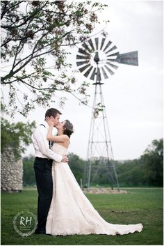 Bride and groom in front of windmill at The Grande Hall at Hofmann Ranch, Castroville, TX