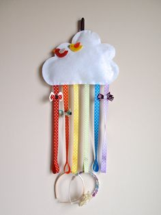 Store your hair clips and hairbands in one place with this whimsical rainbow organizer! This is also a perfect addition to a cloud or rainbow