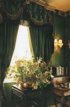 sumptuous emerald velvet draperies richly detailed in gold trimming splendor