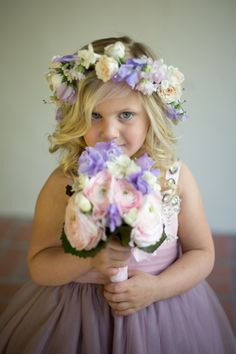 This sweet flower girl carried a beautiful flower arrangement for this elegant Santa Barbara Wedding. See more of this wedding at http://www.merrylbrownevents.com