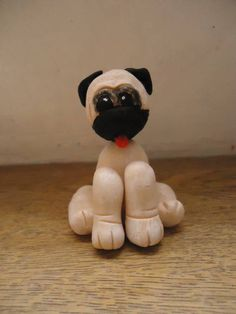 O cachorro exótico PUG em Biscuit  Produto embalado individualmente  O tempo de produção varia conforme quantidade solicitada. R$ 6,00