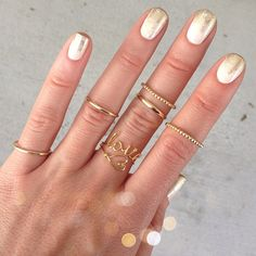 Gold Ombre nails  and rings!