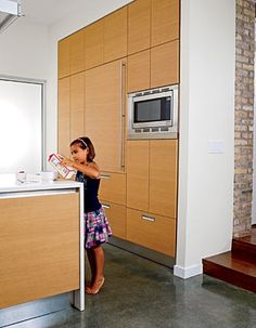 Silestone counters and concrete floors with radiant heat are exceedingly child-friendly.